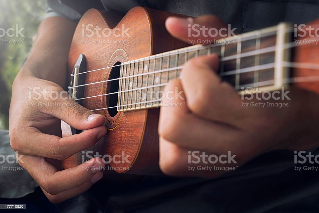 playing Ukulele stock photo
