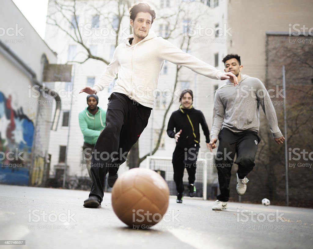 Playing Urban Soccer stock photo