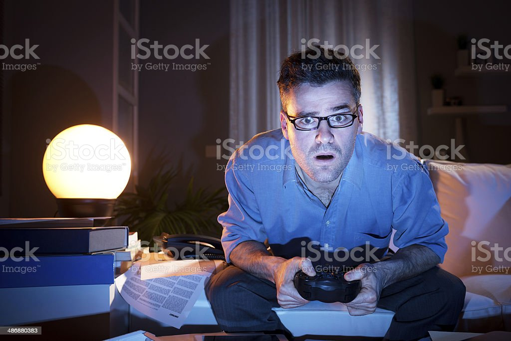 Playing videogames late at night stock photo