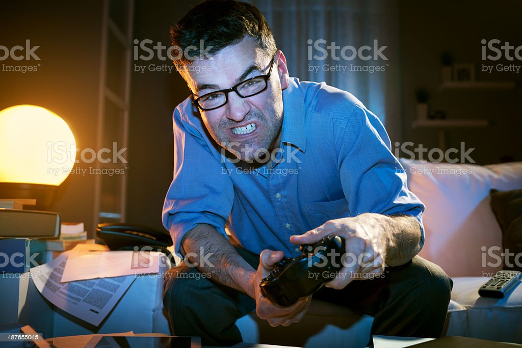 Playing videogames late at night royalty-free stock photo