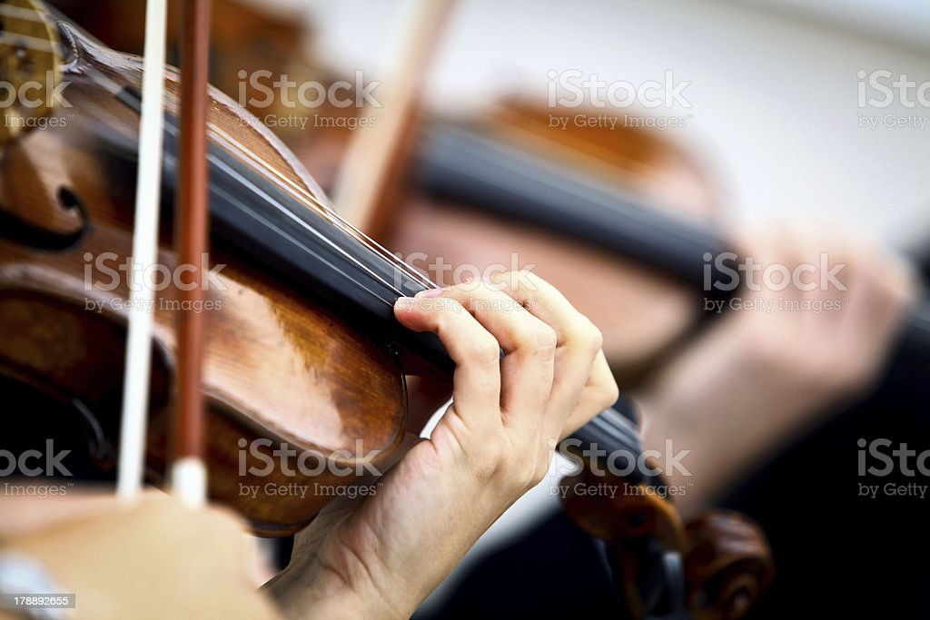Playing violin stock photo