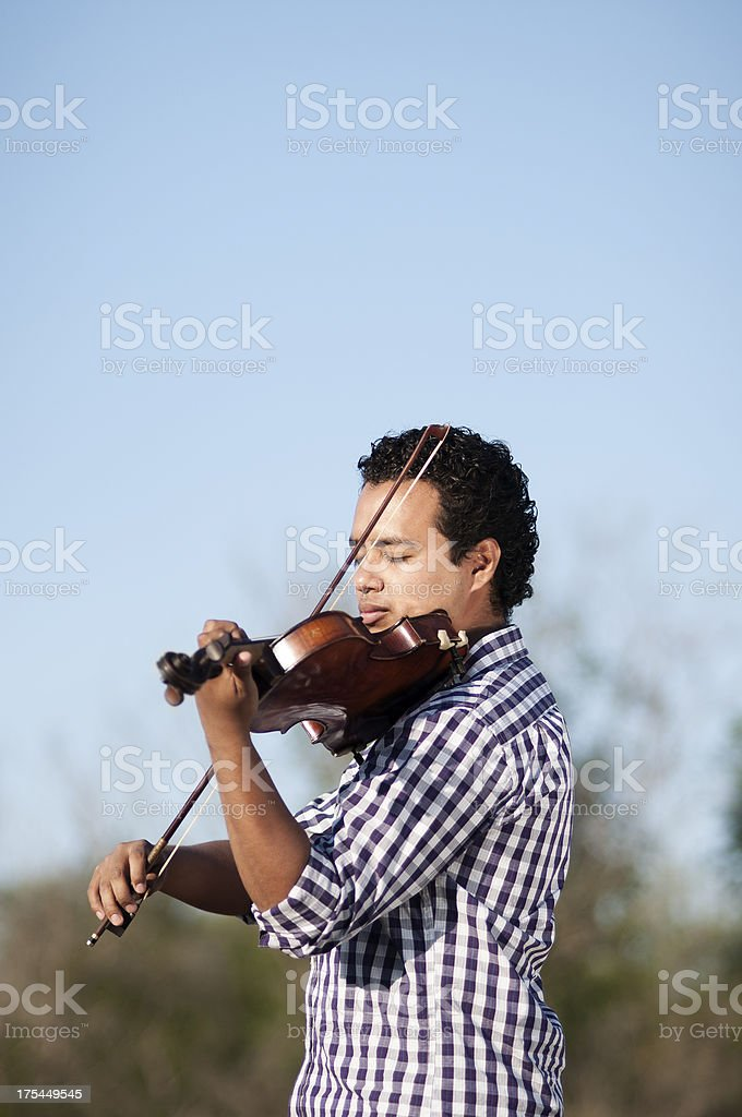 Playing violin student stock photo