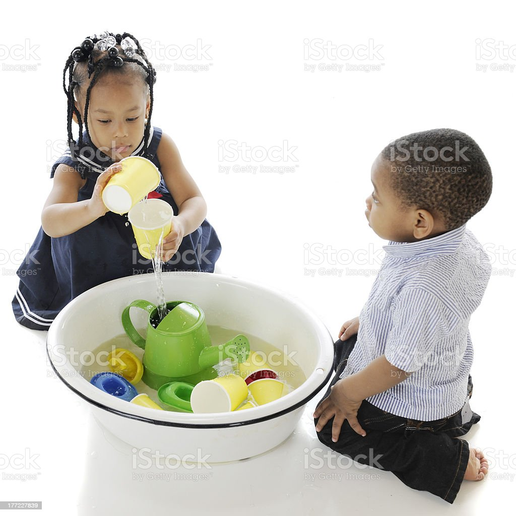 Playing Water Toys in a Tub royalty-free stock photo