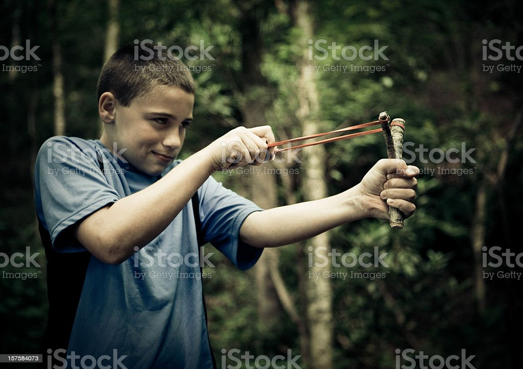 playing with a slingshot stock photo