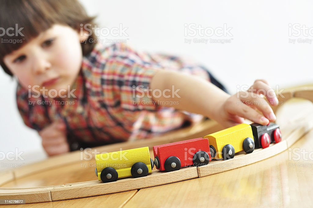 Playing with a toy train stock photo
