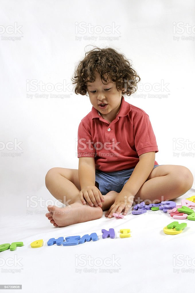 Playing with alphabet stock photo