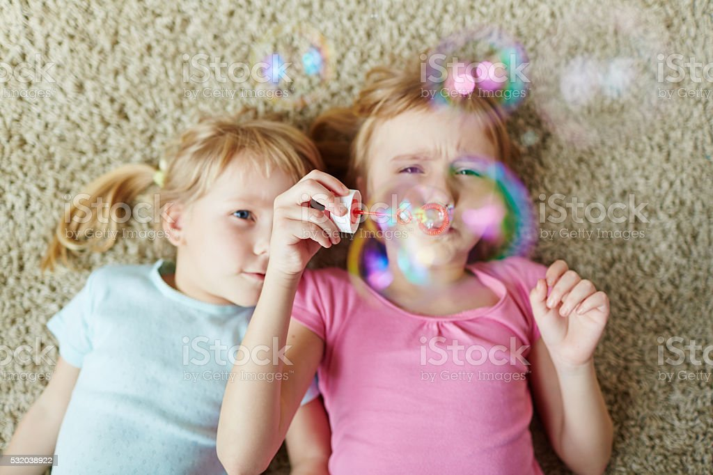 playing with bubbles stock photo