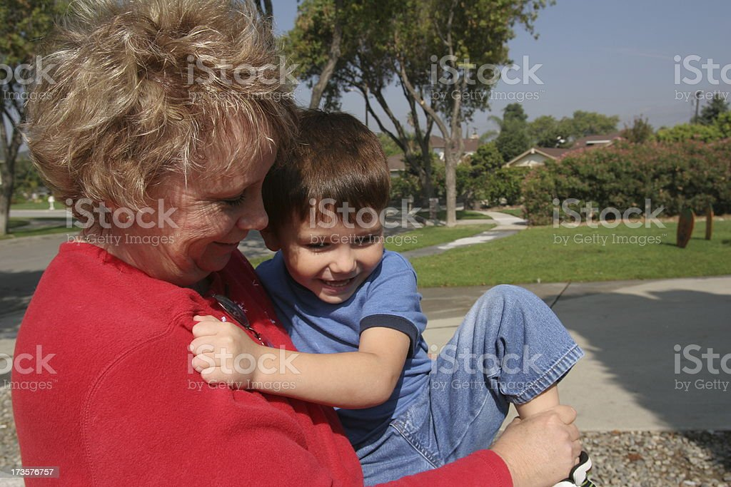 Playing with grandma stock photo