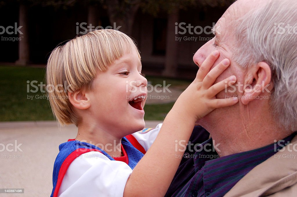 Playing with Grandpa royalty-free stock photo
