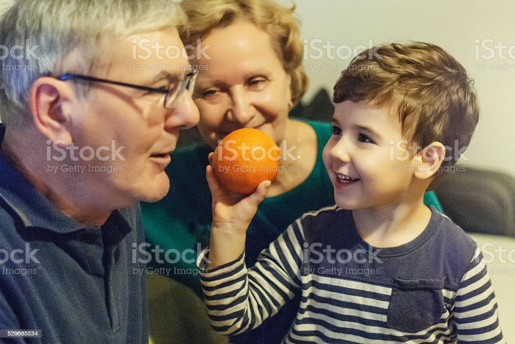 Playing with grandparents stock photo