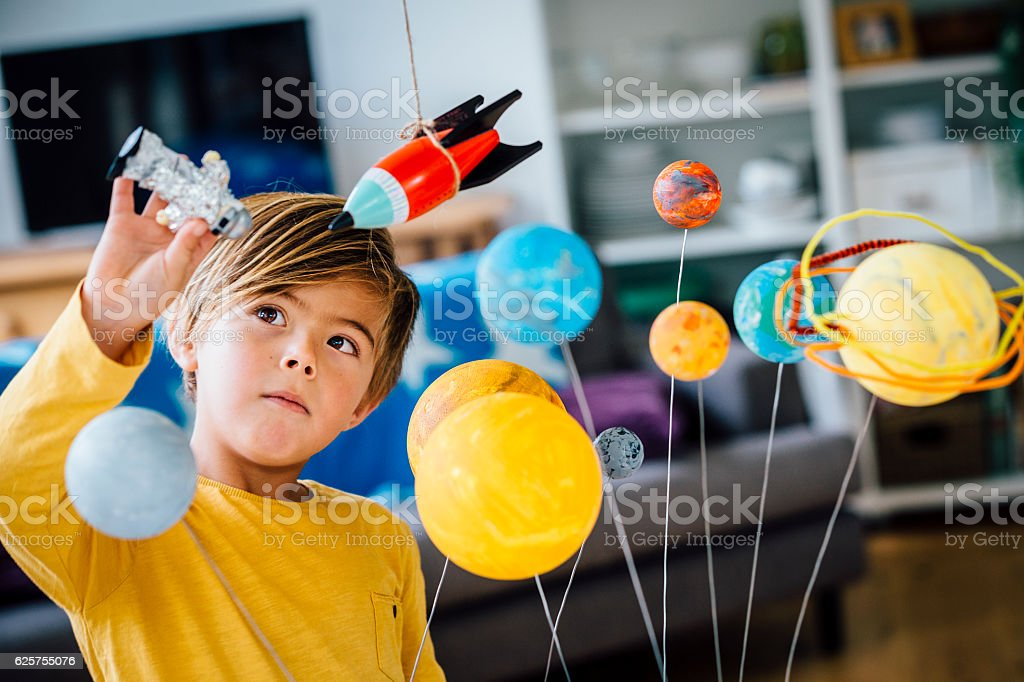 Playing with his Astronaut stock photo