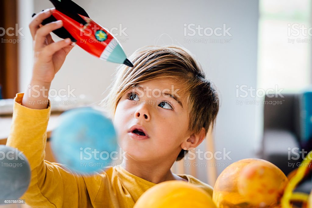 Playing with his Rocket stock photo