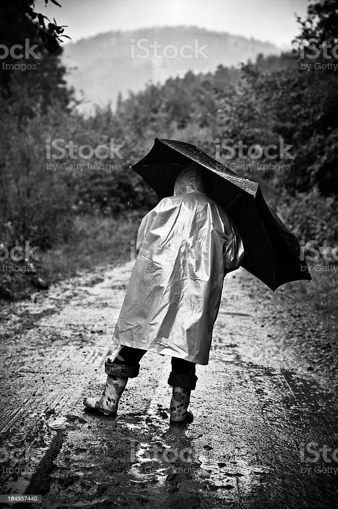Playing with mud in the rain royalty-free stock photo