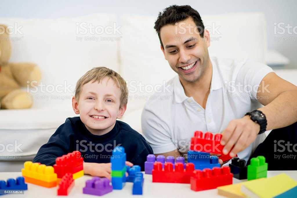 Playing with Plastic Blocks stock photo