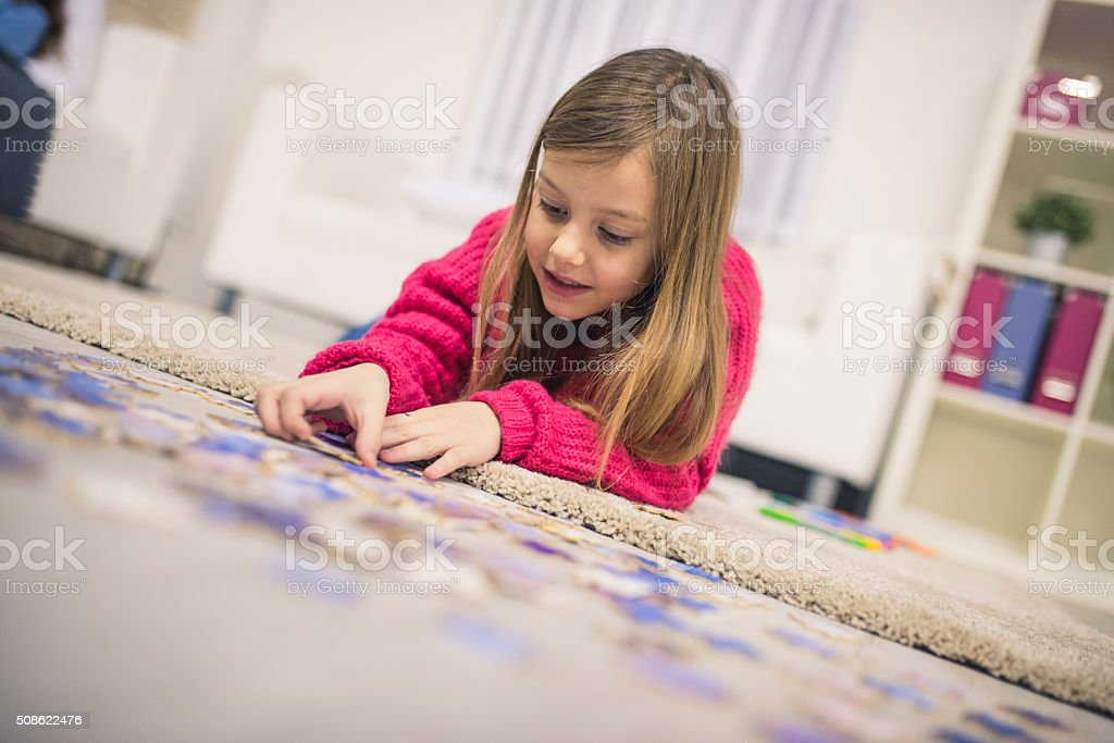 Playing with puzzels stock photo