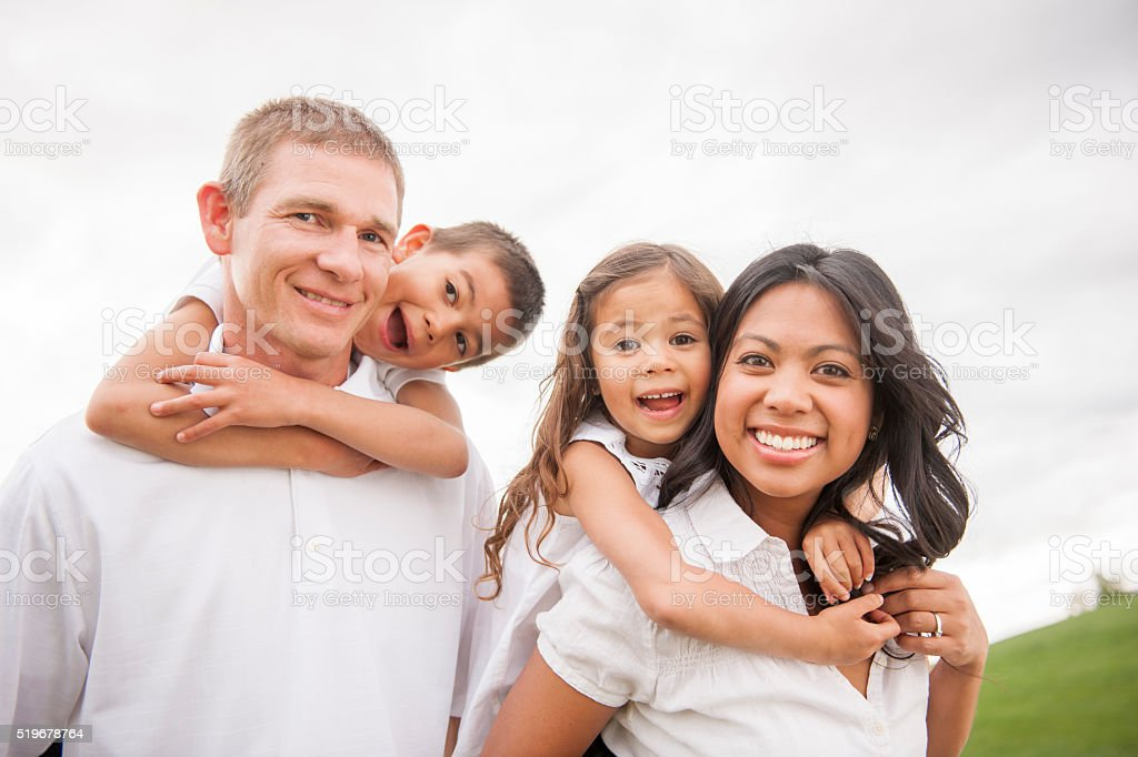 Playing with Their Children Outside stock photo