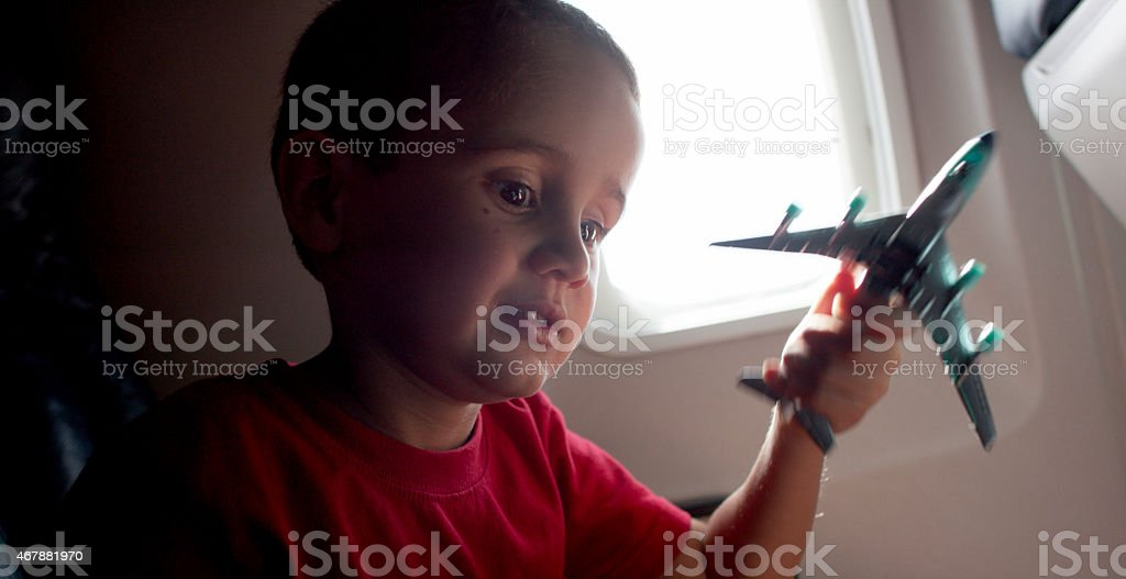 Playing with Toy Airplane on Airplane stock photo
