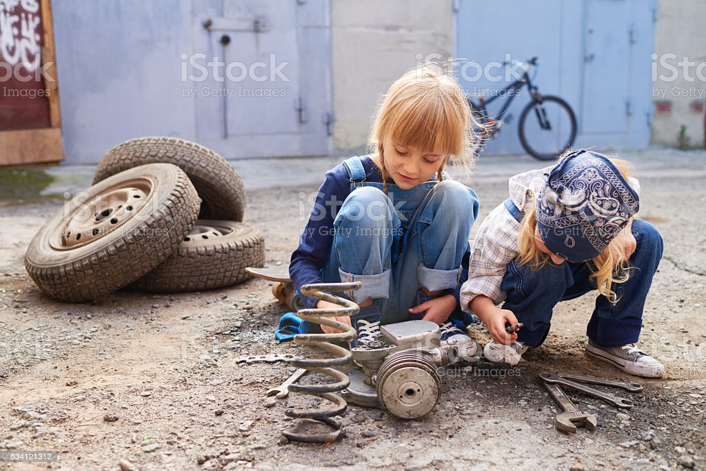 Playing with vehicle parts stock photo
