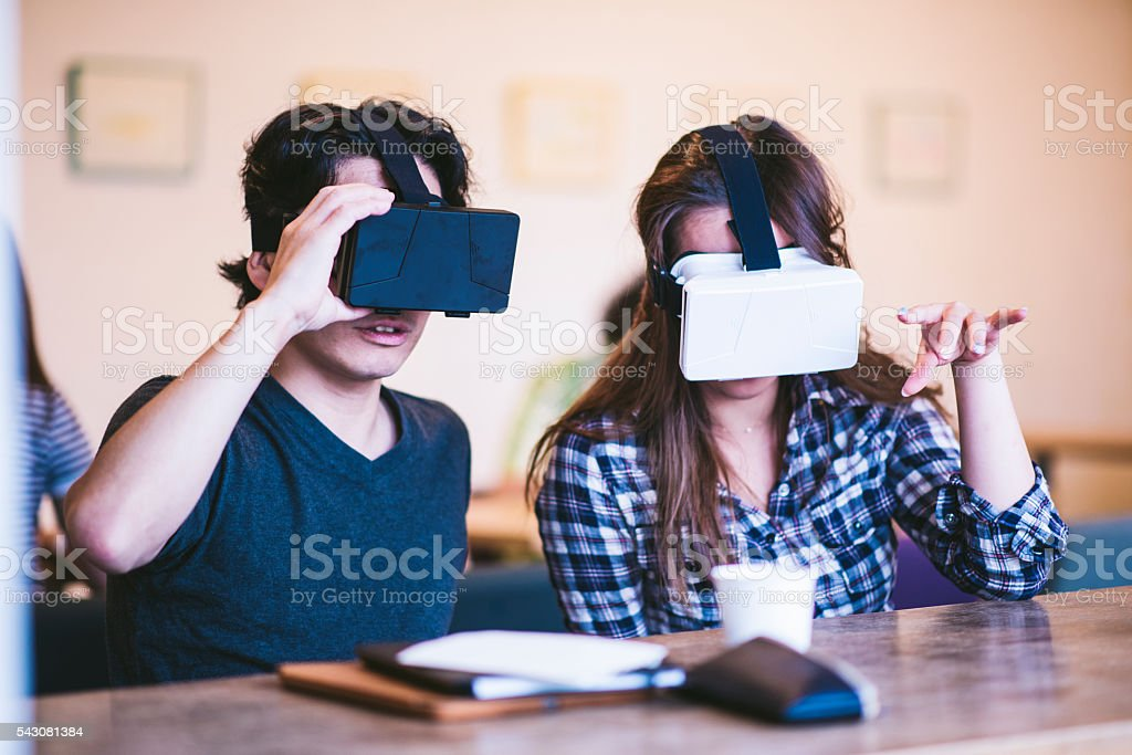 Playing with virtual reality simulators stock photo
