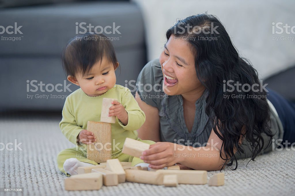 Playing with Wood Blocks stock photo