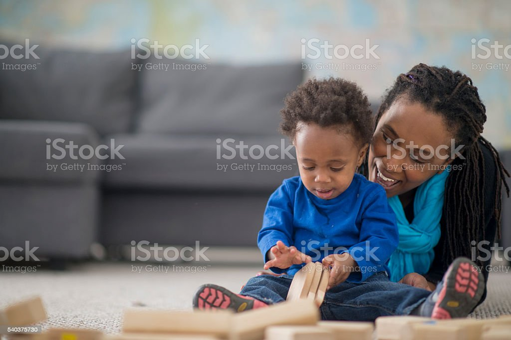 Playing with Wooden Blocks stock photo
