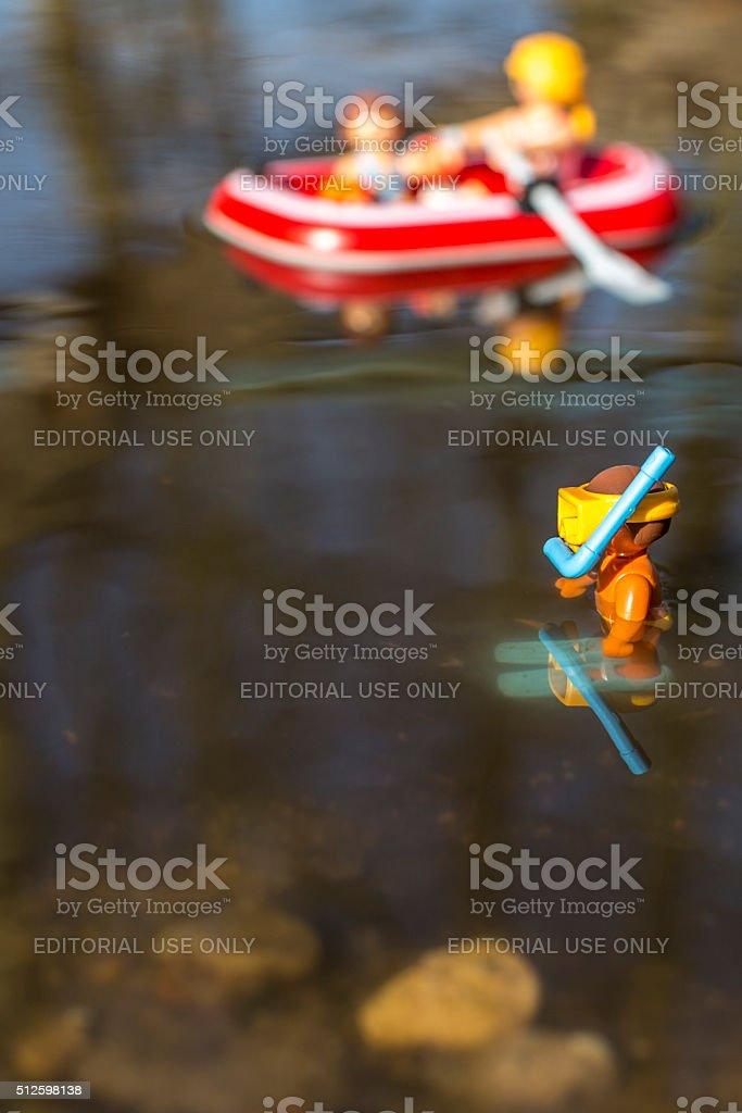Playmobil child figurine snorkling stock photo