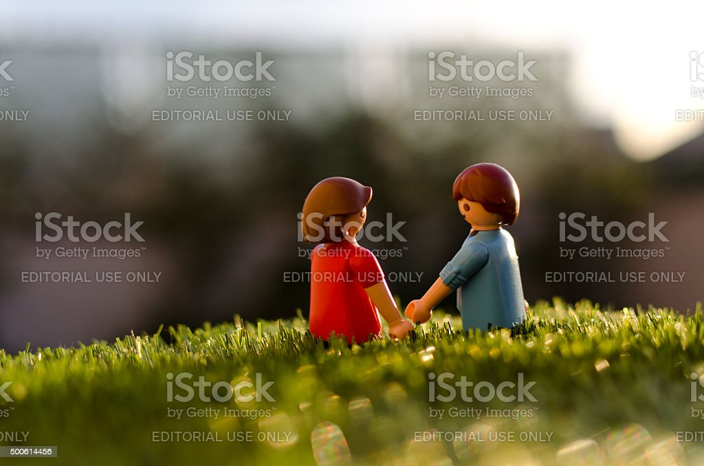 Playmobil couple, man and women holding hands. stock photo
