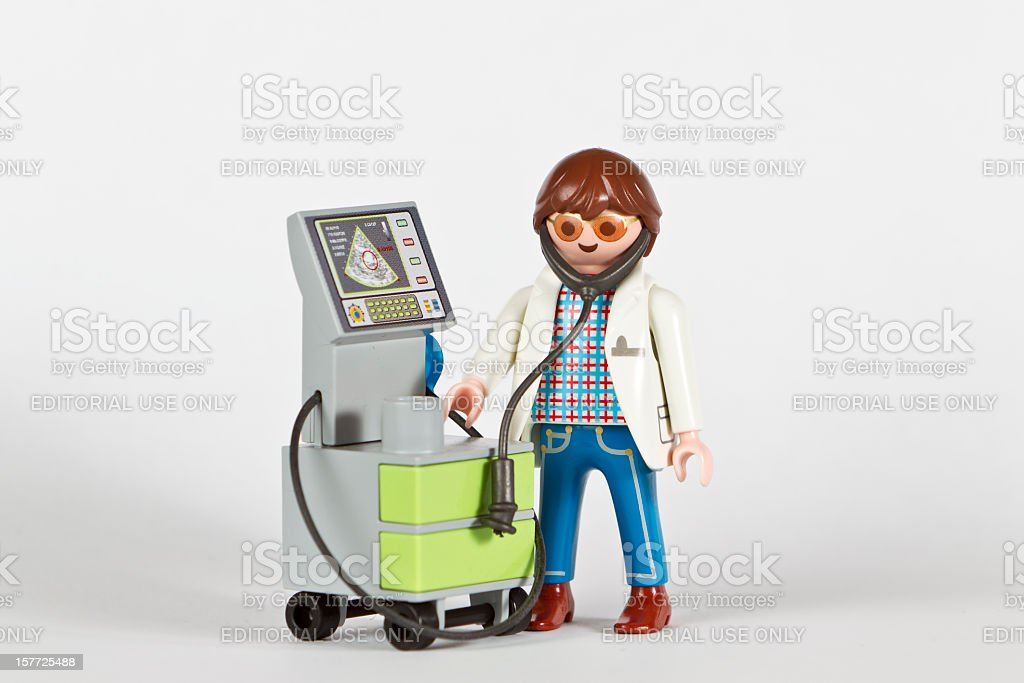 Playmobil Doctor PHD with ultrasound examination device stock photo