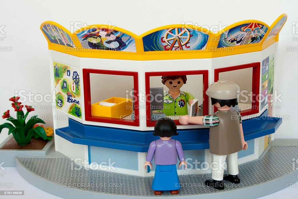 Playmobil people to buy tickets for the Ferris wheel stock photo