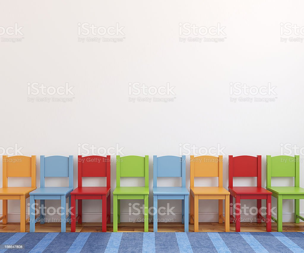 A playroom with colorful chairs royalty-free stock photo