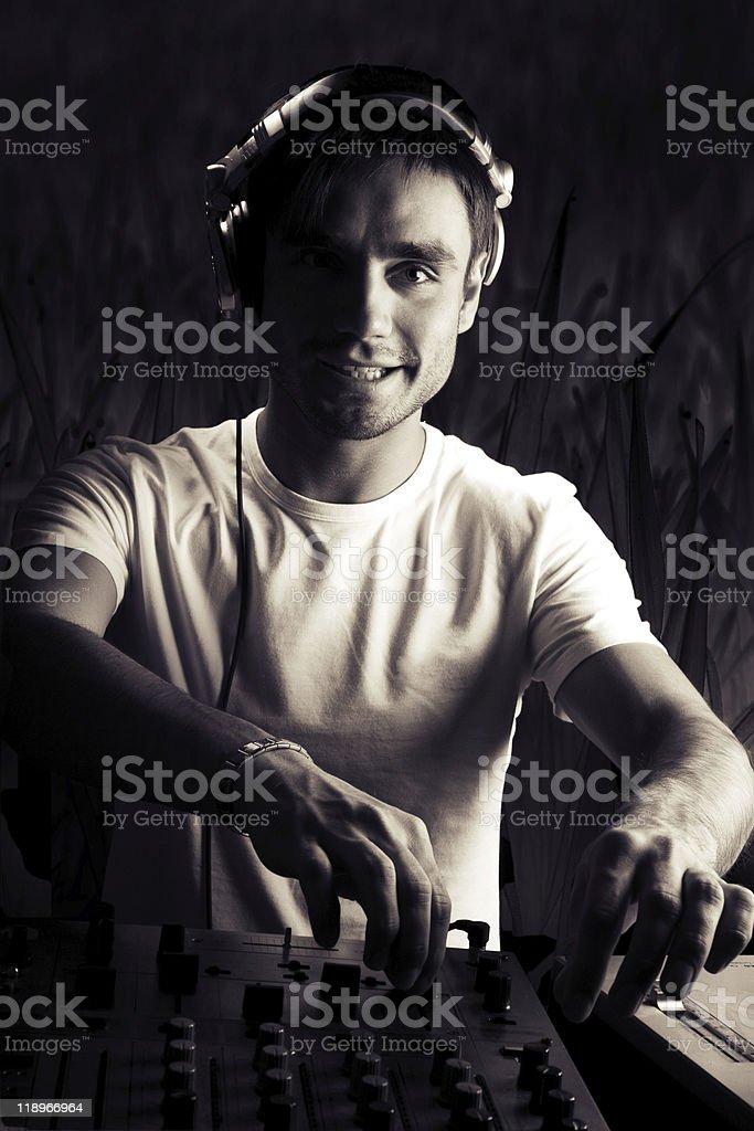 DJ plays set royalty-free stock photo