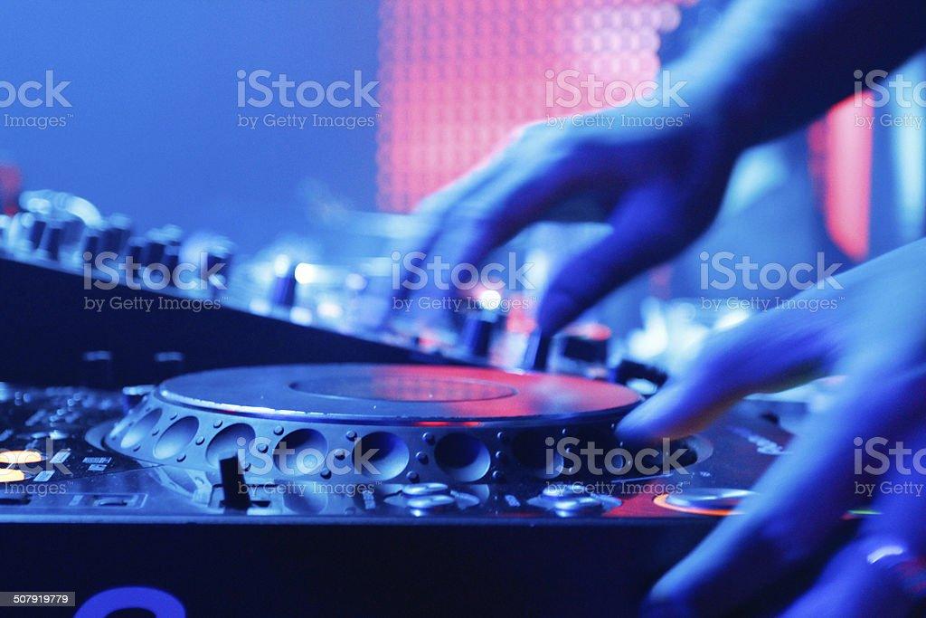 DJ plays turntable stock photo