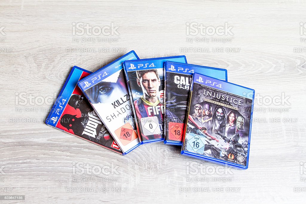 Setting with some playstation 4 games. Playstation 4 is an product of...