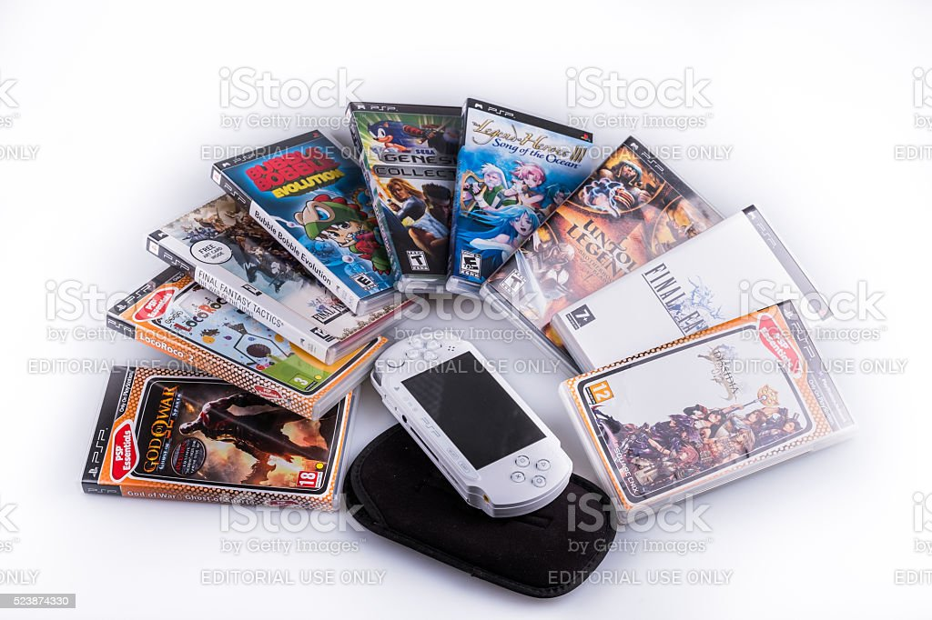 Playstation Portable with games stock photo