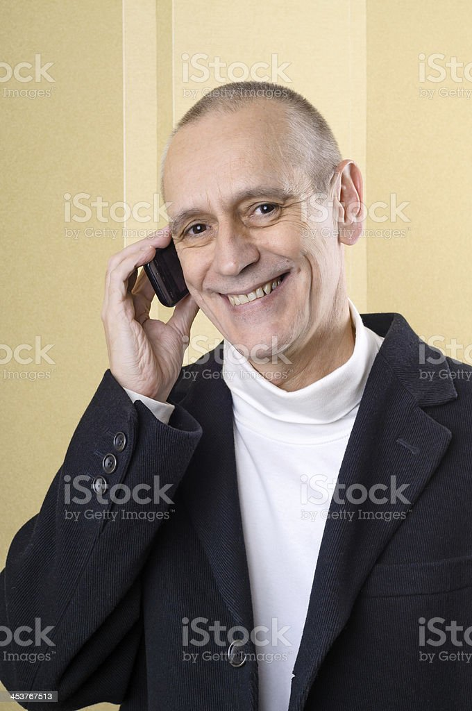 Pleasant and Smiling Man on Phone stock photo