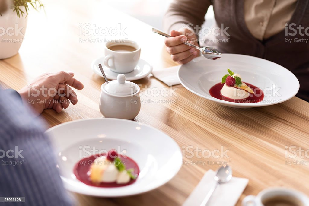 Pleasant colleagues having a lunch stock photo