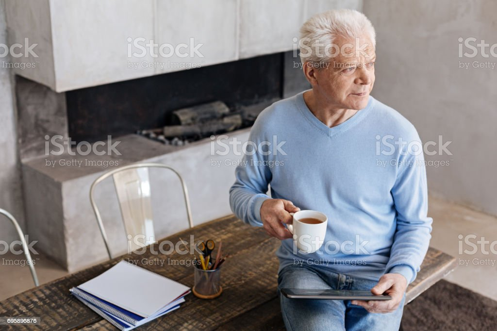 Pleasant curious man having a productive morning stock photo