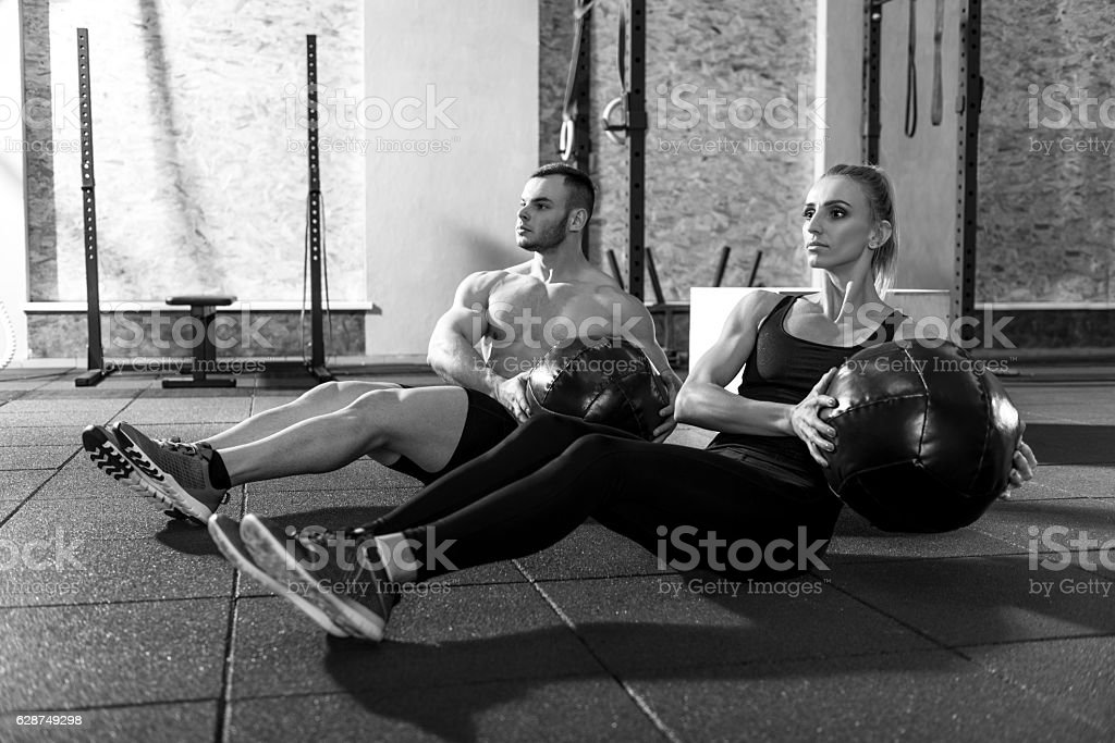 Pleasant good looking workout partners training together stock photo