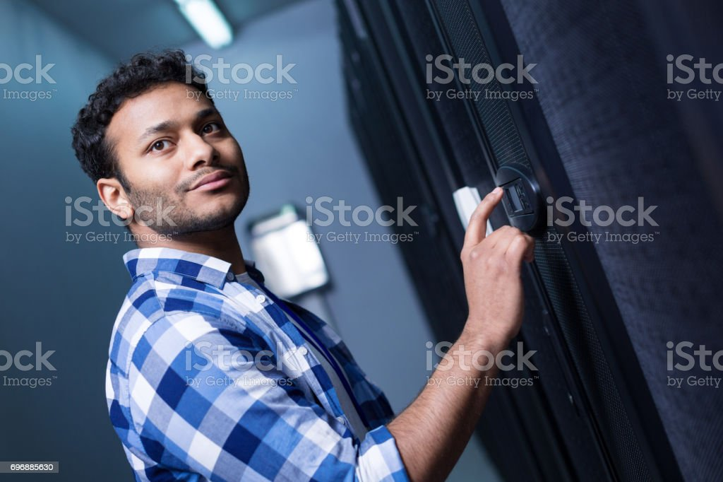 Pleasant nice man setting up the electronic lock stock photo