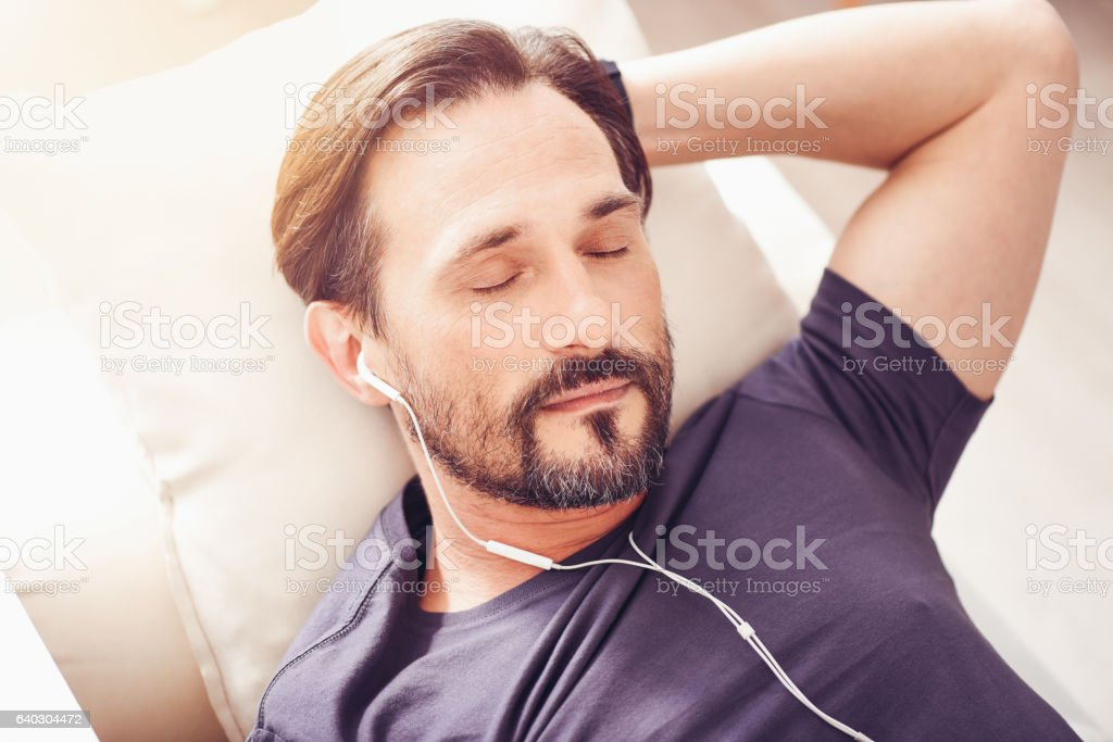 Pleasant relaxed man sleeping at home stock photo