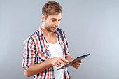Pleasant student holding laptop
