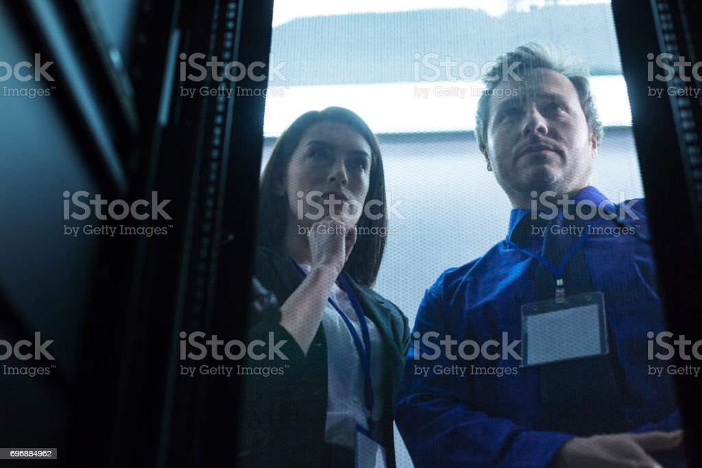 Pleasant thoughtful woman holding her chin stock photo
