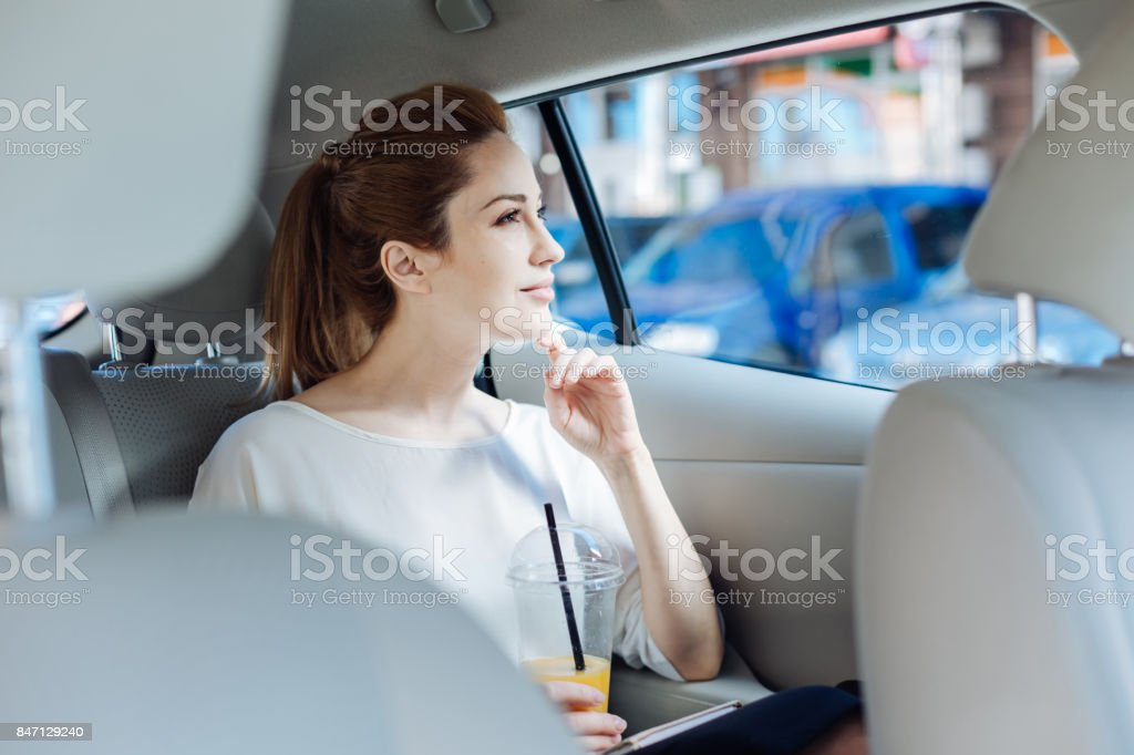 Pleasant thoughtful woman looking into the window stock photo