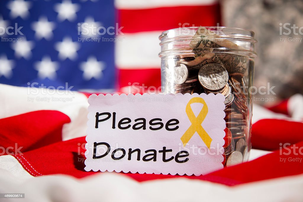 'Please Donate' note, collection jar. American flag. Fundraiser for military. stock photo