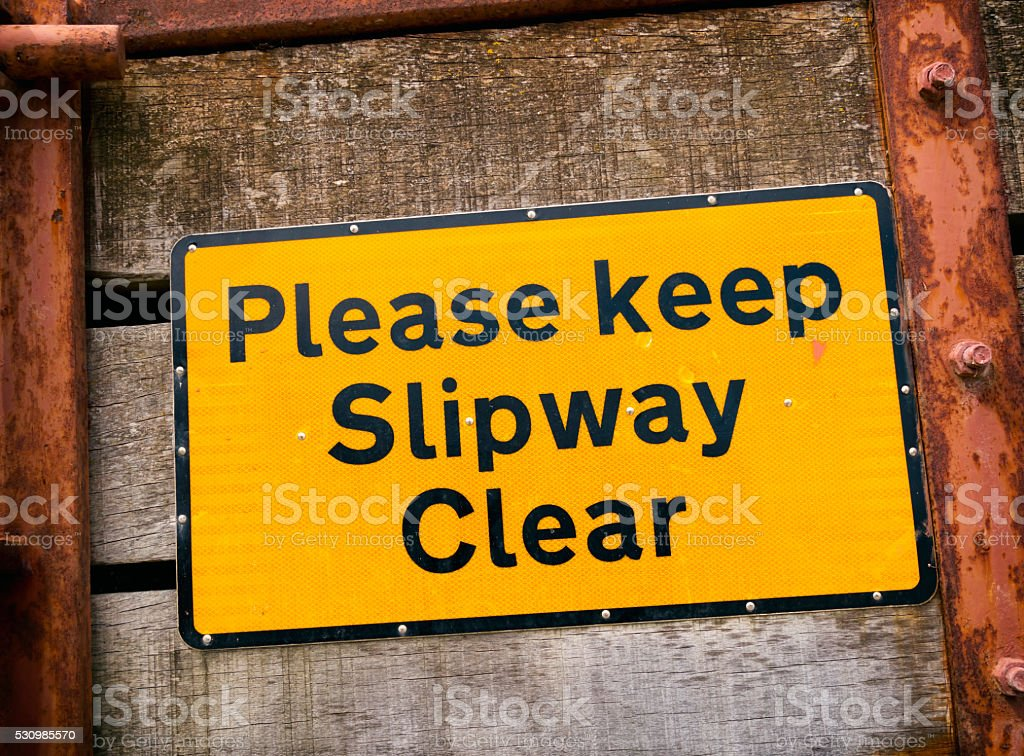 Please keep slipway clear - sign stock photo