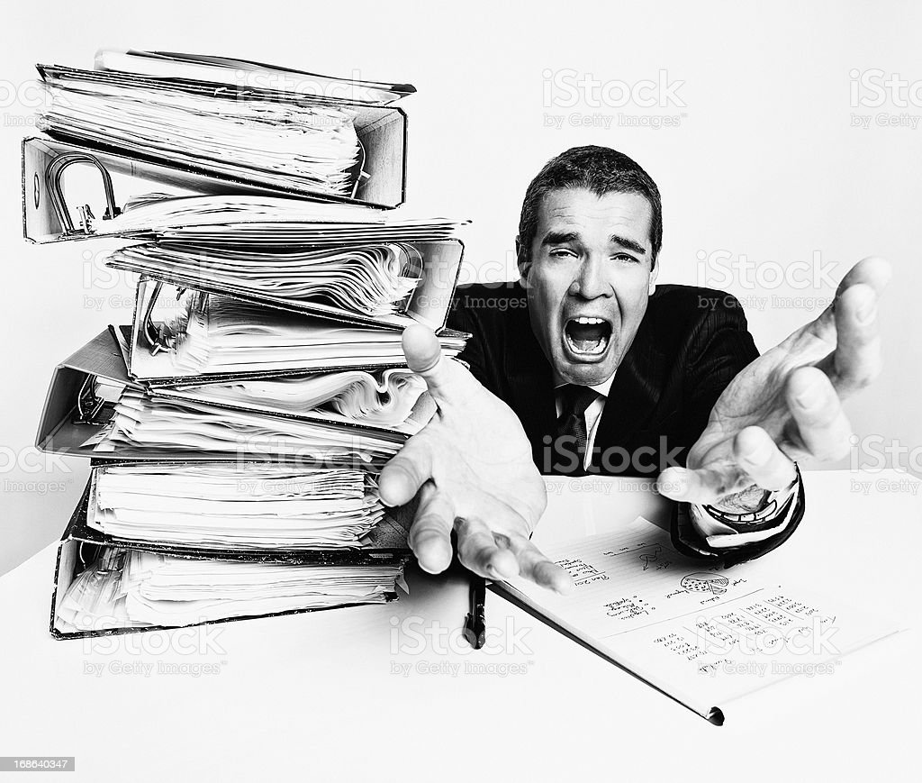 Please release me! Desperate businessman begs relief from work overload royalty-free stock photo