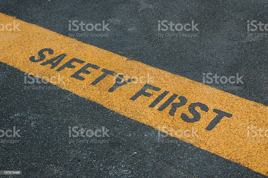 Please stand behide the yellow line! stock photo