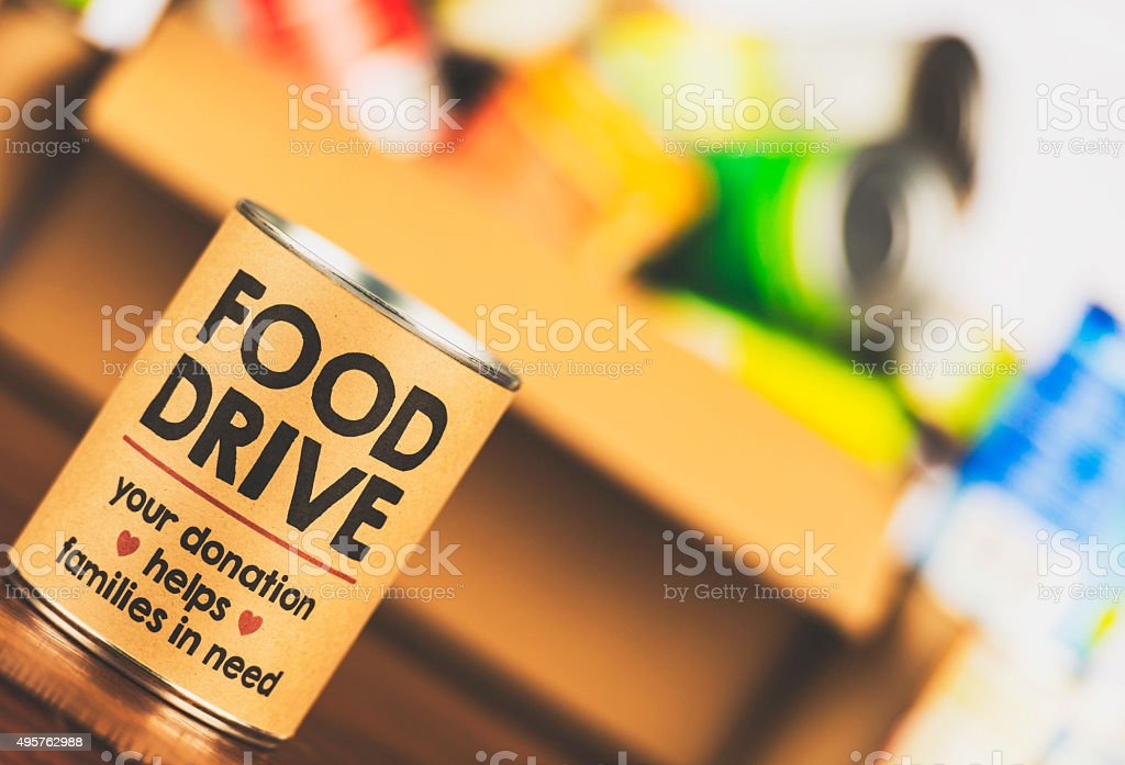 Please support our food drive. Canned food drive stock photo