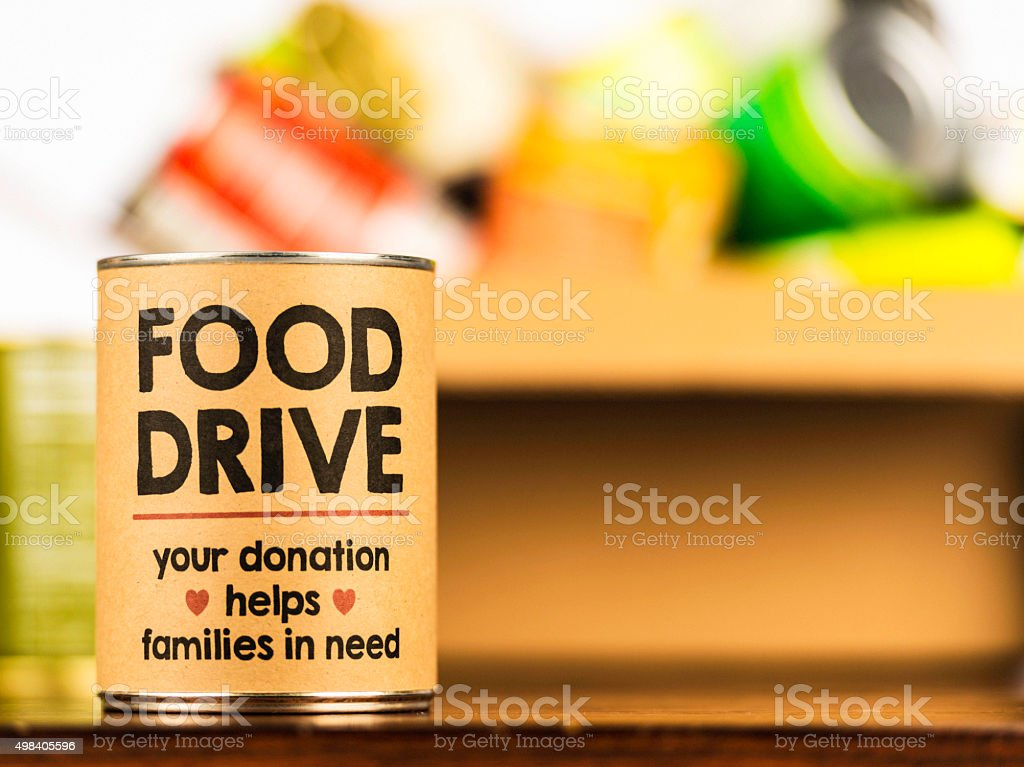 Please support our food drive. Holiday canned food drive stock photo