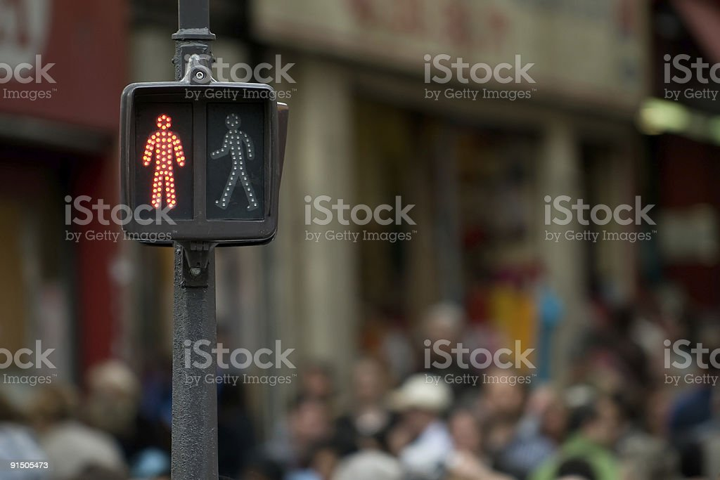 Please wait - Red pedestrian Light in a shopping zone stock photo